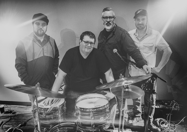 From left to right: Kelvin Kaspar - Guitar, Mike Malone - Drums, Matt Vanderlinden - Bass, Greg McMonagle - Vocals