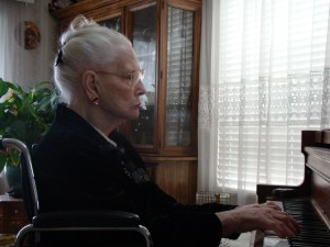 My Grandma at age 100, who always was an accomplished pianist and opera singer. She played piano several hours every day until she passed away at 102 years old!