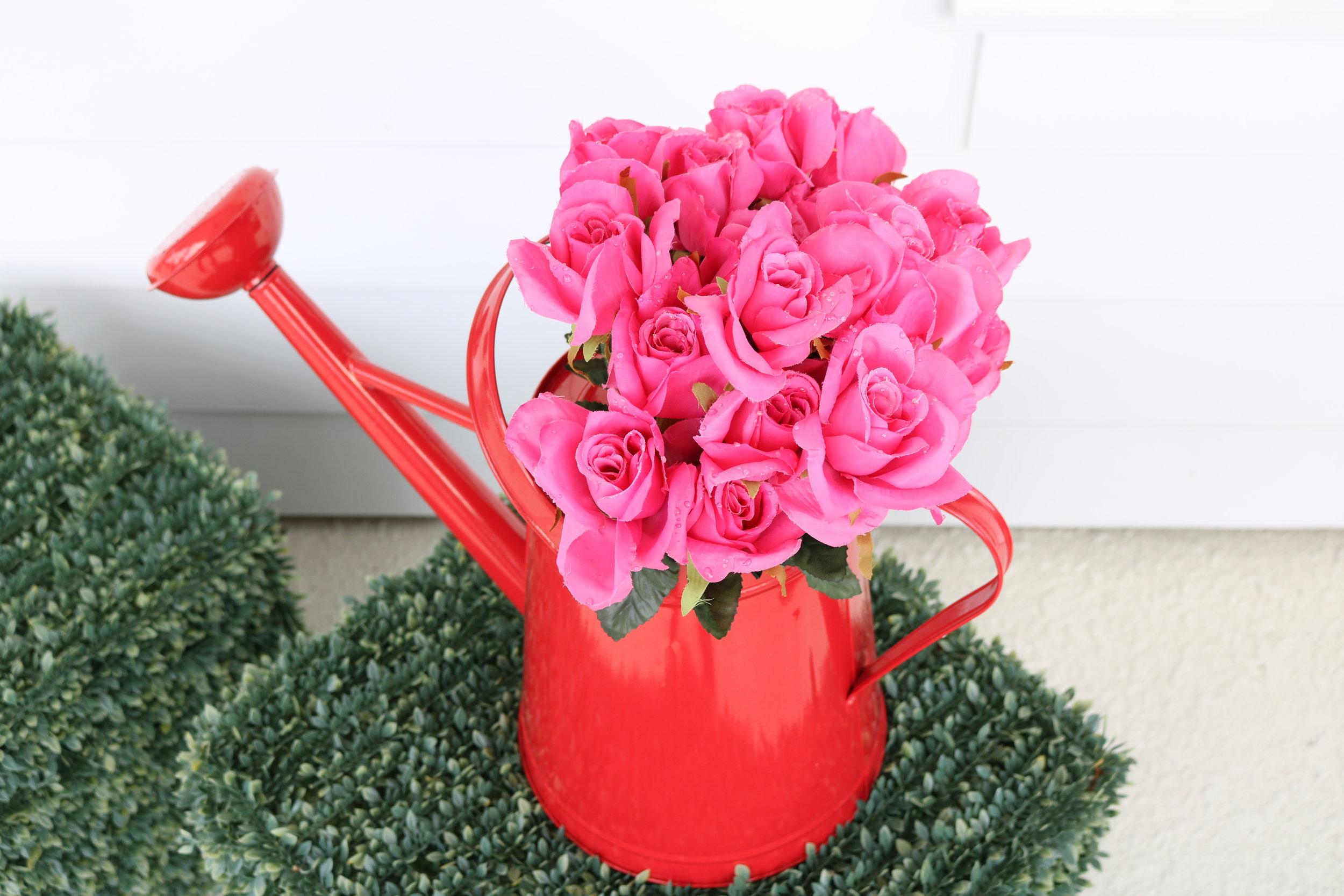 roses in water can.JPG