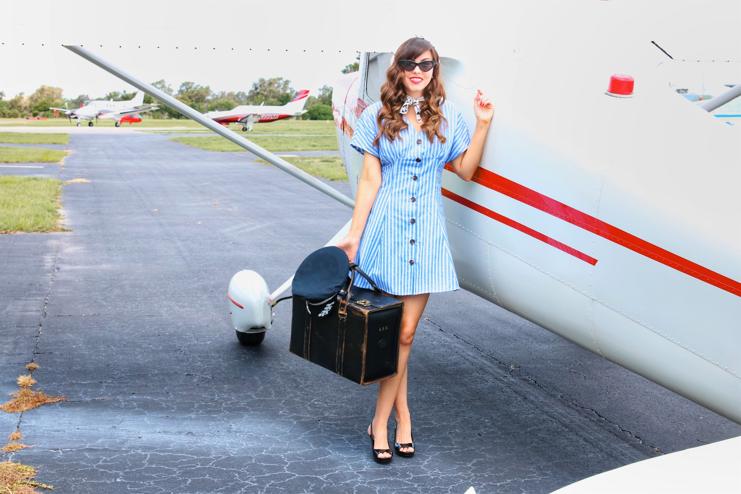 blue striped dress and plane.jpeg