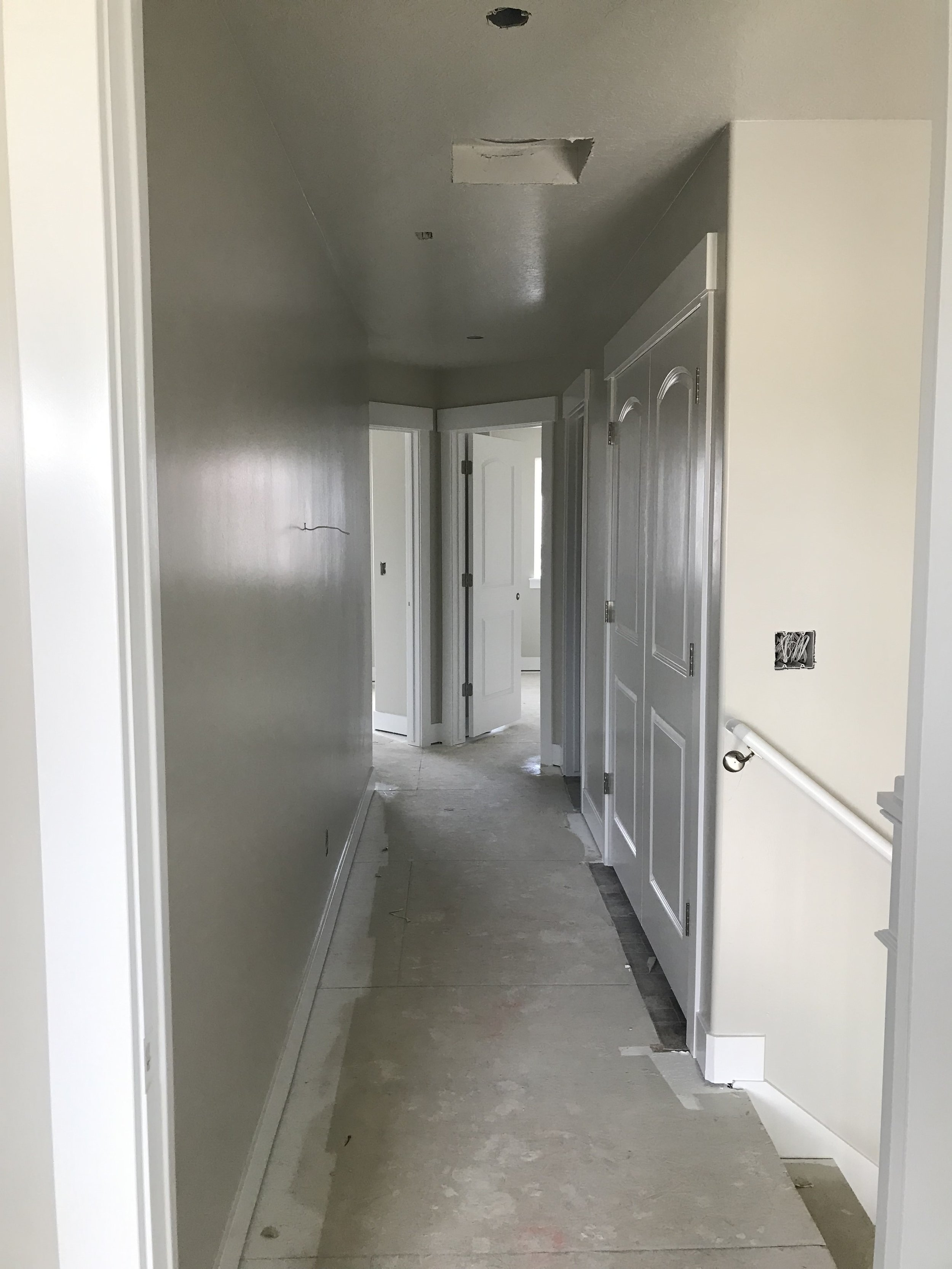 View of the upstairs hallway after painting.
