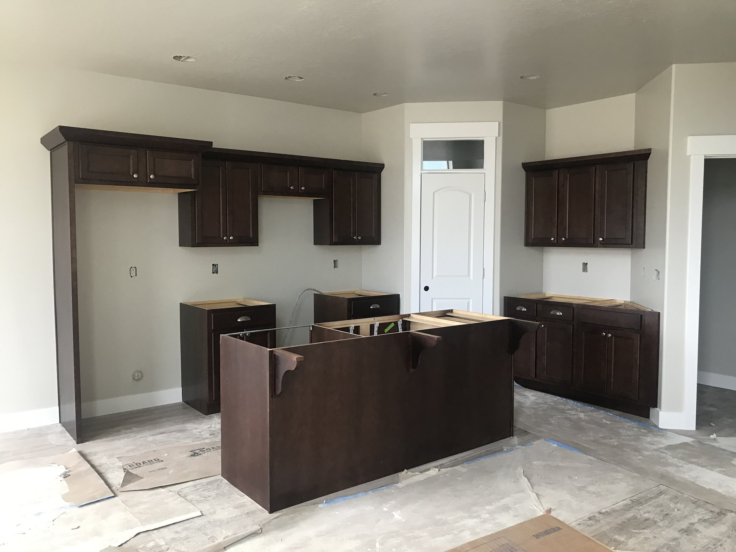 Cabinets installed in the kitchen. They're the same color in the bathrooms as well.
