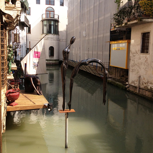 A sculpture over a canal in Treviso, Italy