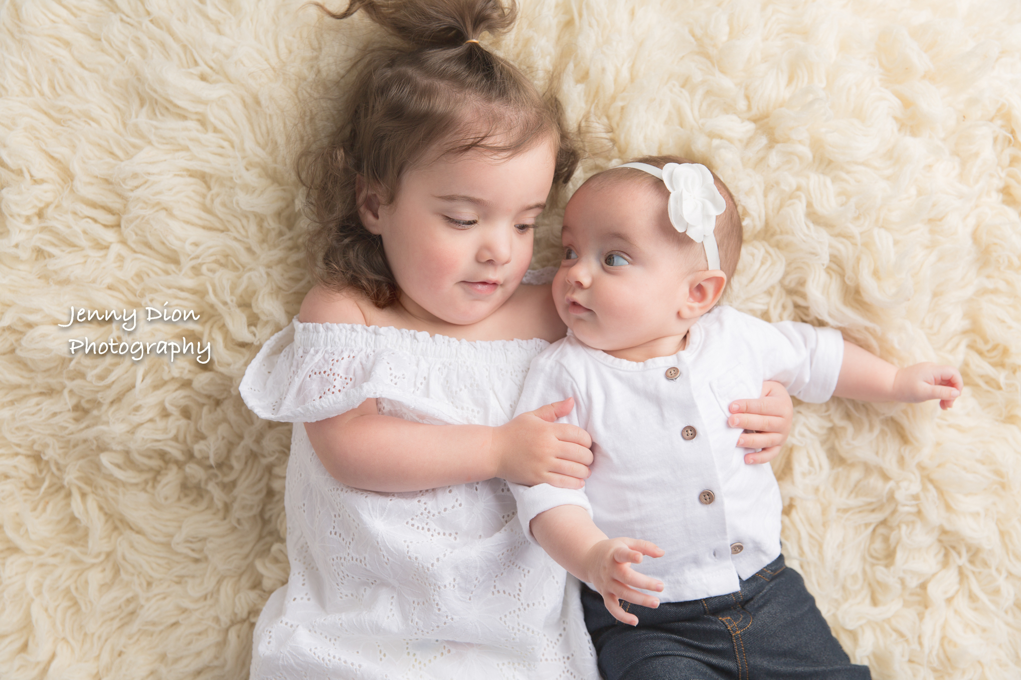With her baby sister.