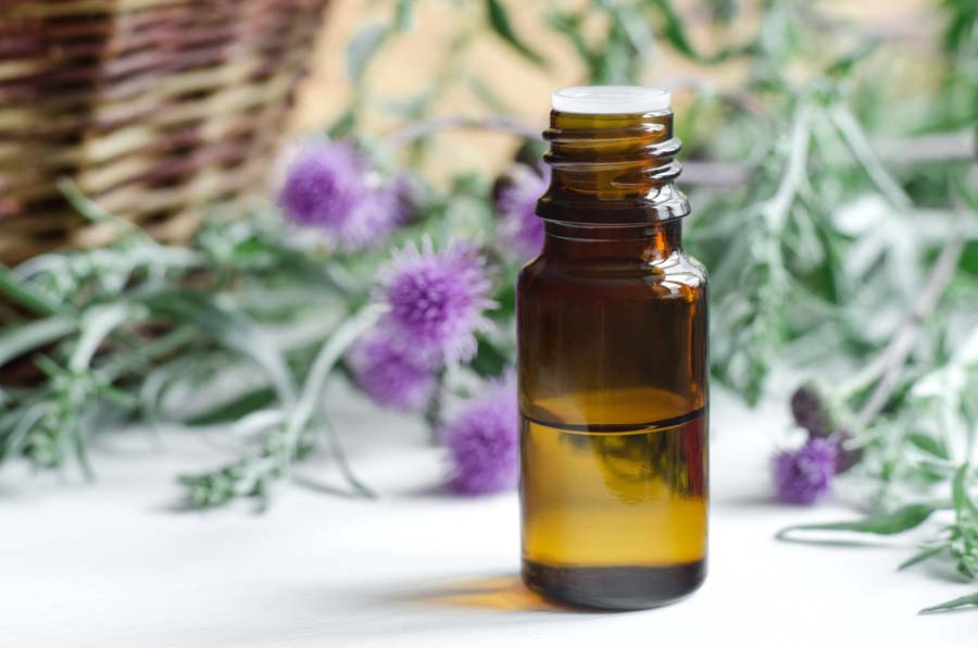 essential-oil-bottle-with-basket-and-thistle.jpg