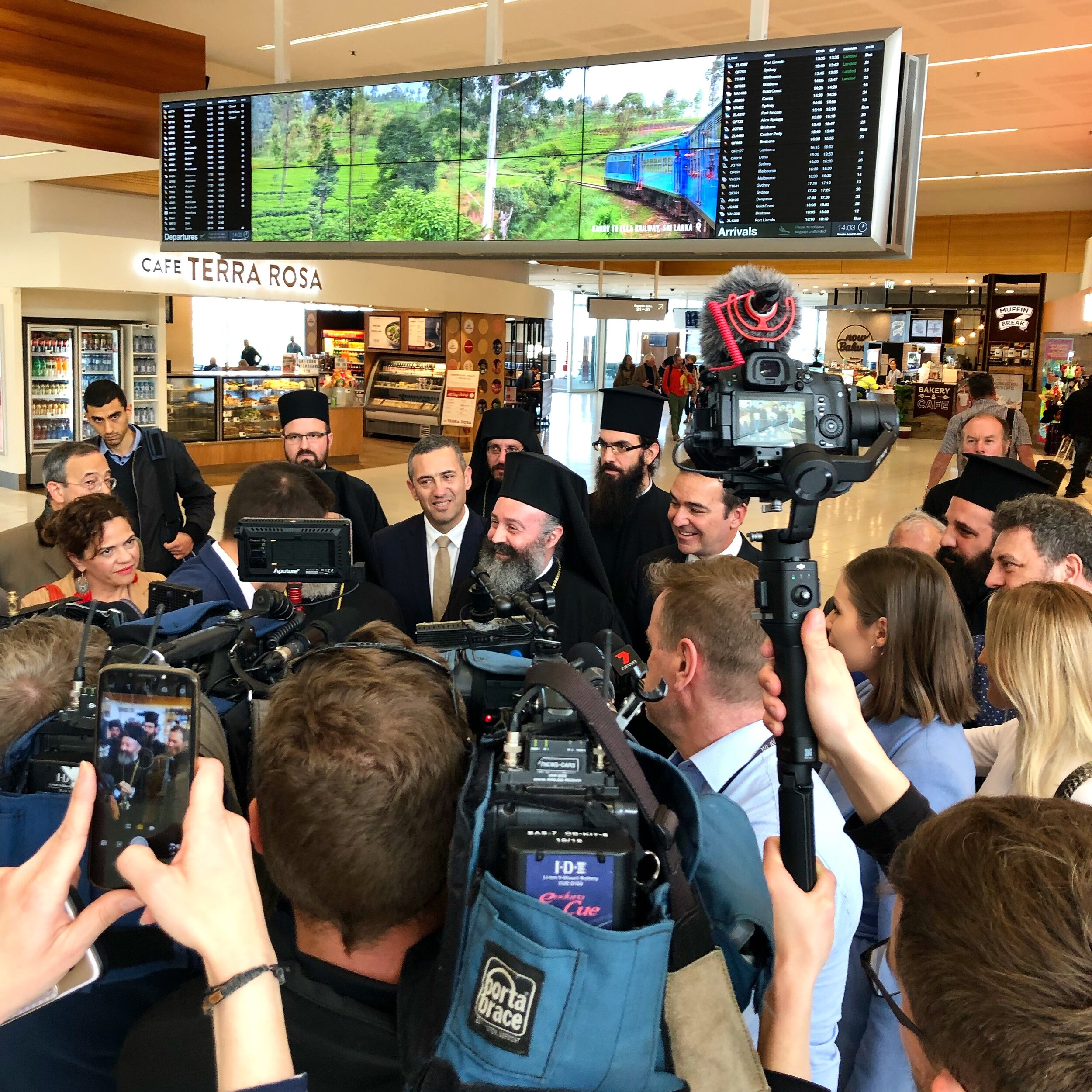 The arrival of His Eminence, Archbishop Makarios at Adelaide Airport for his first official visit to Adelaide
