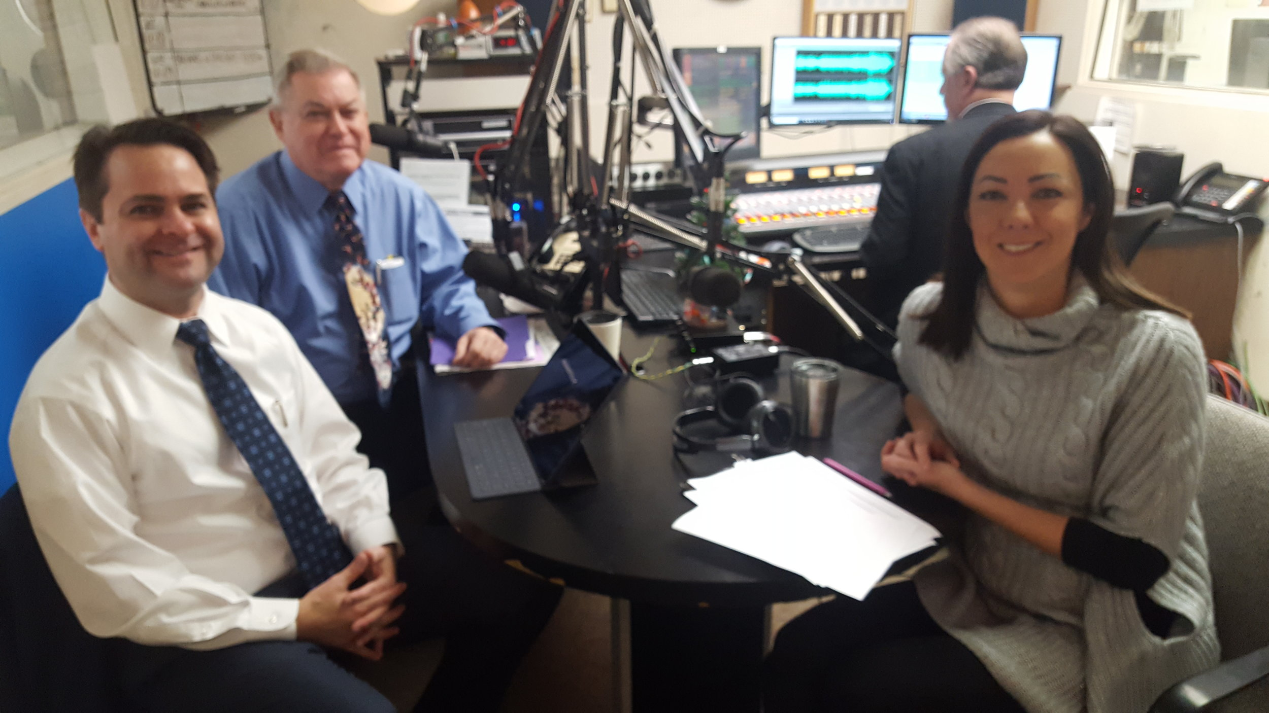 L-R: Pharmacists Brad and Paul White discuss the flu with Canton City Health Department's Amanda Archer, epidemiologist.