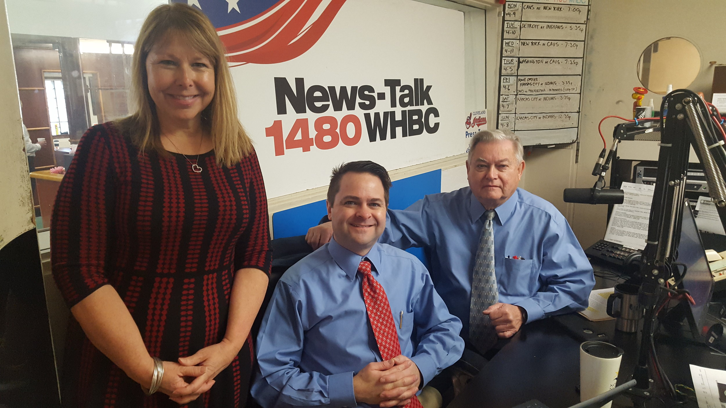 L-R: Valerie Stutler, American Heart Association social events director discusses Move More month and the 2018 Heart Ball with hosts and pharmacists, Brad White and Paul White.