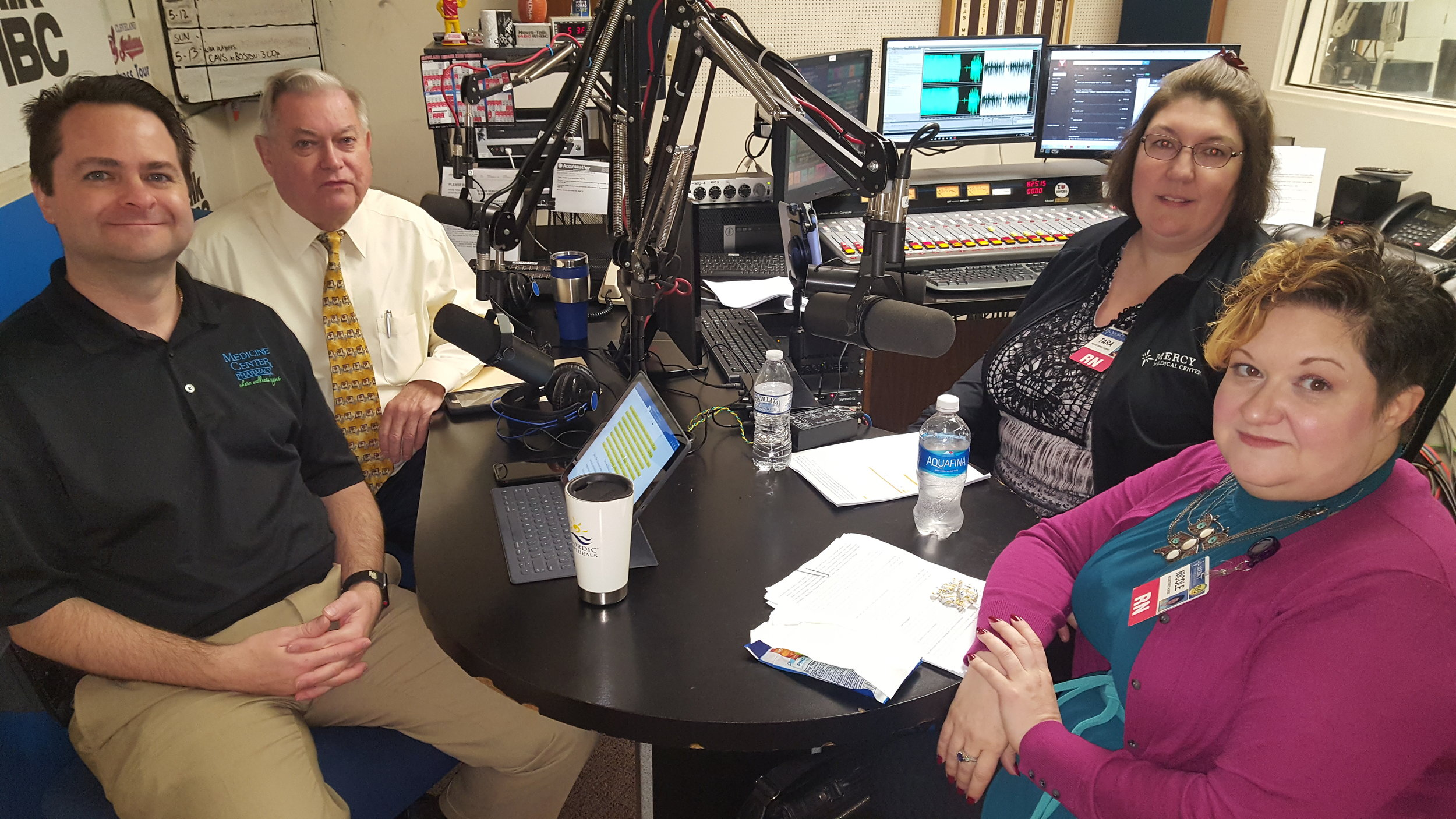 L-R: Brad and Paul White, hosts and pharmacists talk with nurse navigators, Tara Barker, RN, and Nicole Haines, RN, of Mercy Cancer Center.
