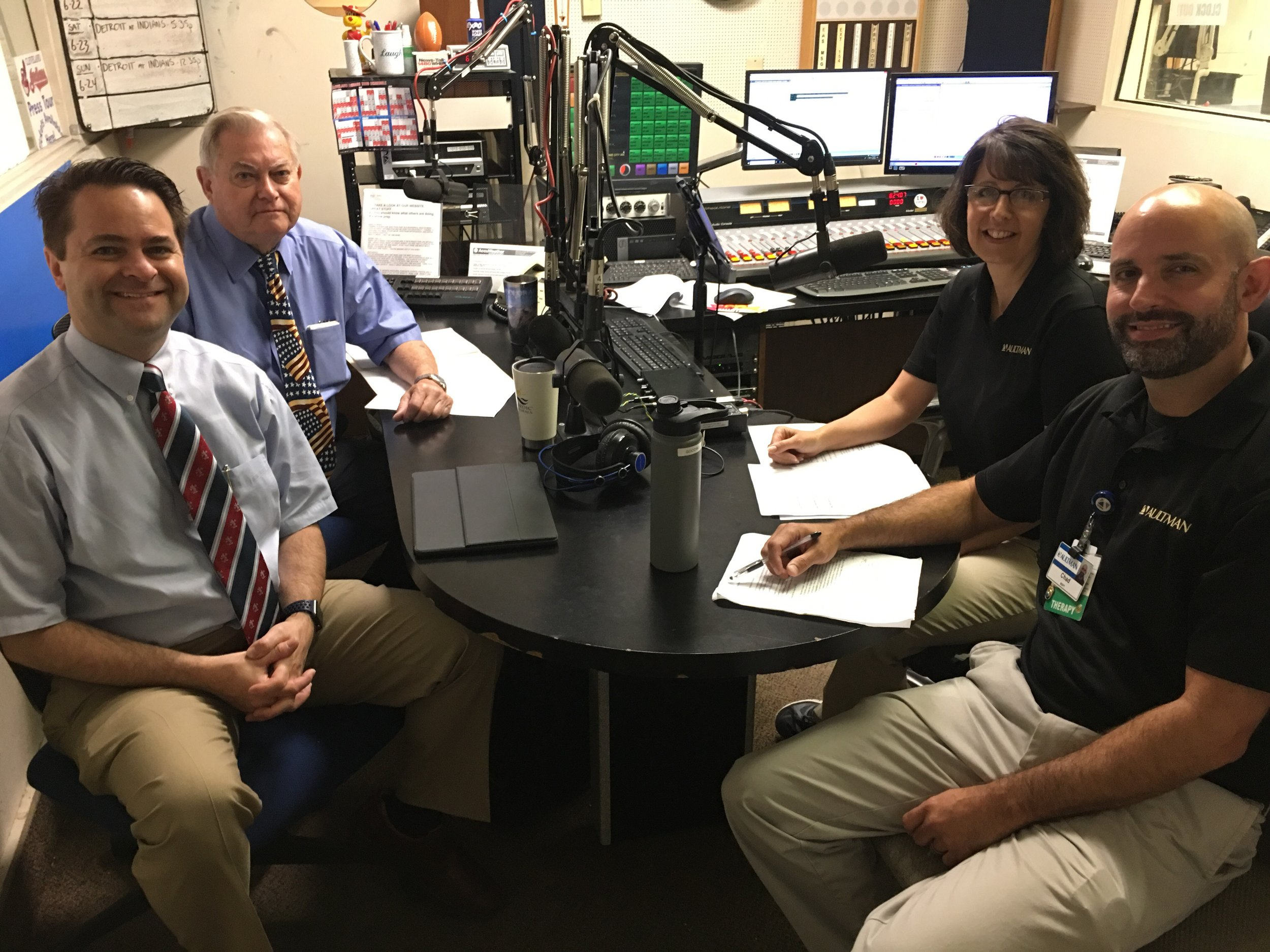 From left, Brad White and Paul White discuss Parkinson's Disease with Aultman Hospital's Michelle Sommers and Chad Gooding.