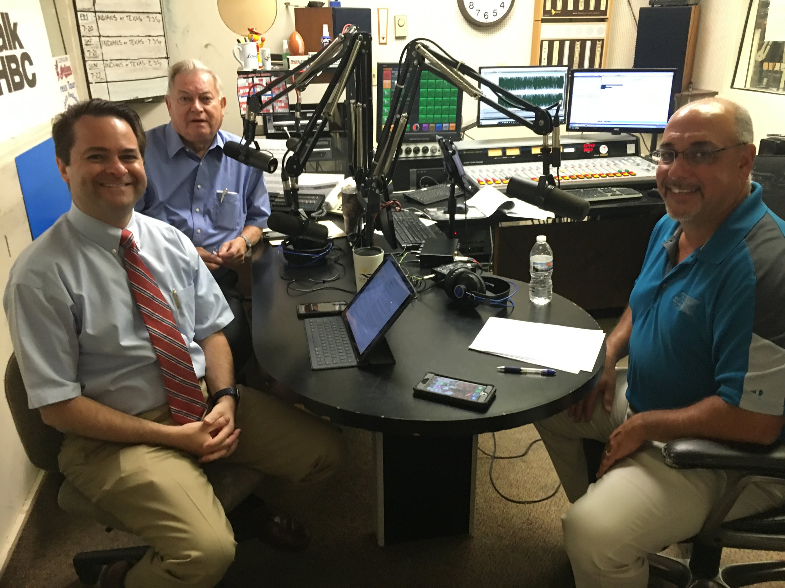 L-R: Hosts and pharmacists, Brad and Paul White talk with Jim Contini, attorney for Krugliak, Wilkins, Griffiths & Doughtery Co., LPA