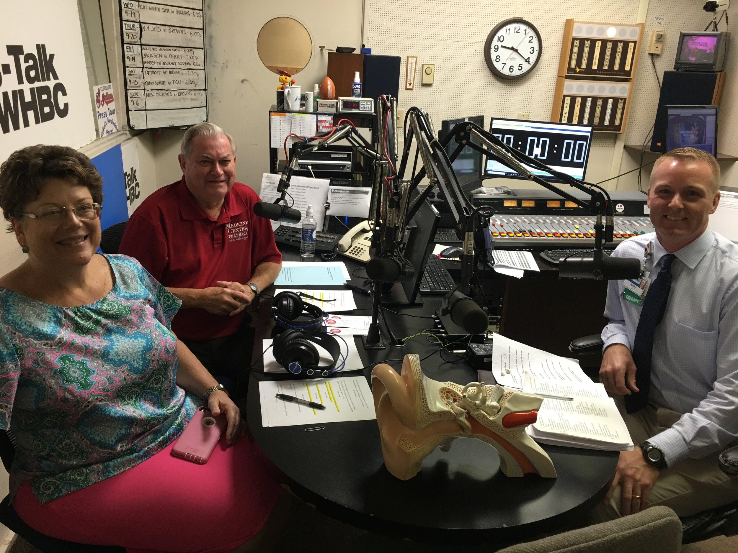 L-R: Medicine Center Pharmacy's Executive Vice President Nancy Wharmby and Pharmacist Paul White talk with Andy Beltz, physical therapist from Aultman Hospital.
