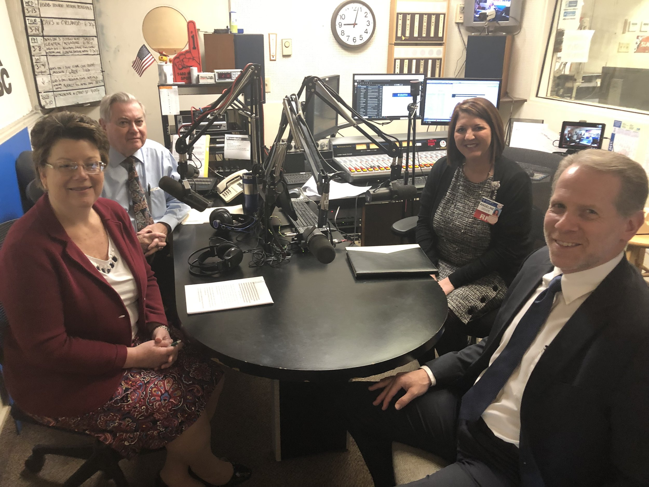 L-R: Medicine Center Pharmacy's Nancy Wharmby, executive vice president and Paul White, R. Ph., discuss colon cancer awareness and treatment with Mercy Medical Center's Angelina Barbato, cancer nurse navigator and Dr. Russell Ramey.
