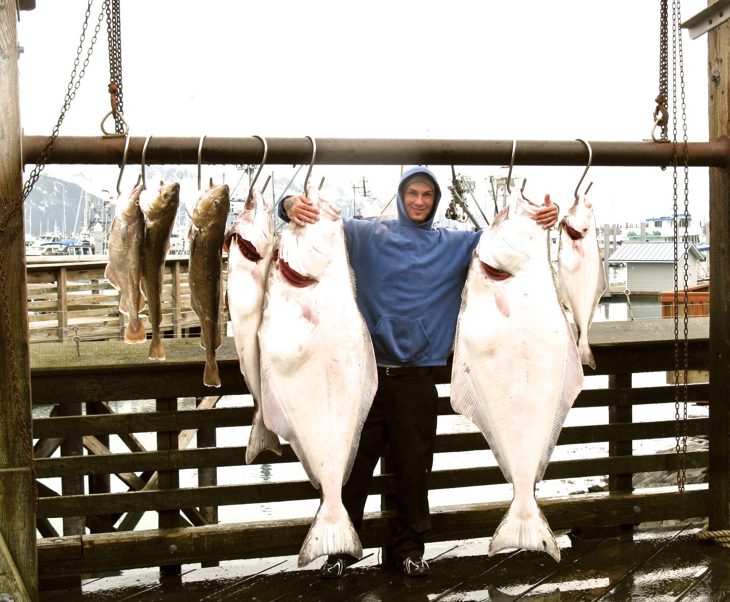 Jerald with Alaskan Halibut he caught in Seward.