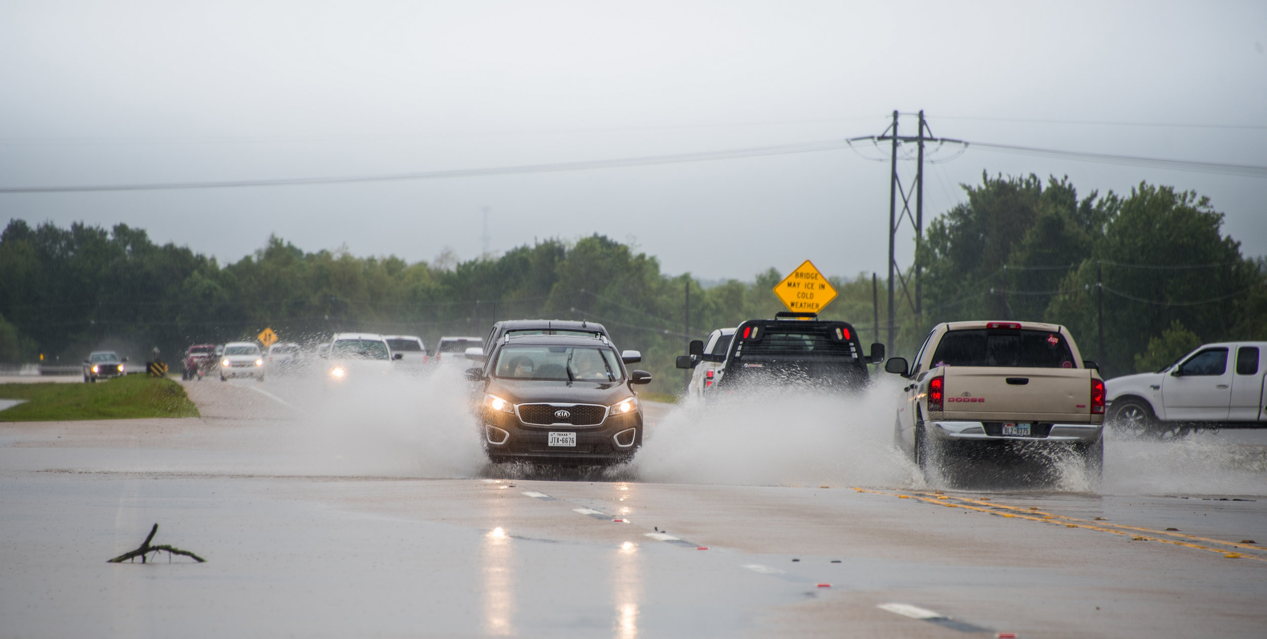 State Highway 242, close to The Woodlands, starts to flood while vehicles try to pass during Hurricane Harvey in Conroe, TX, United States on August 29, 2017