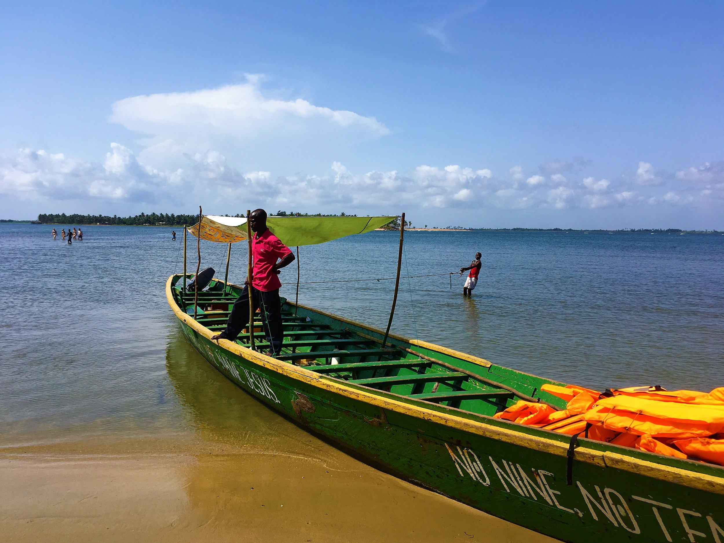 The boat that we took to our island. The boy in the water holding the rope was most likley a child slave.JPG