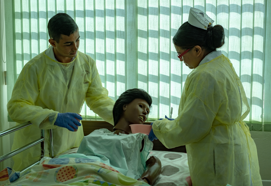 Nursing students practice on a dummy before going live