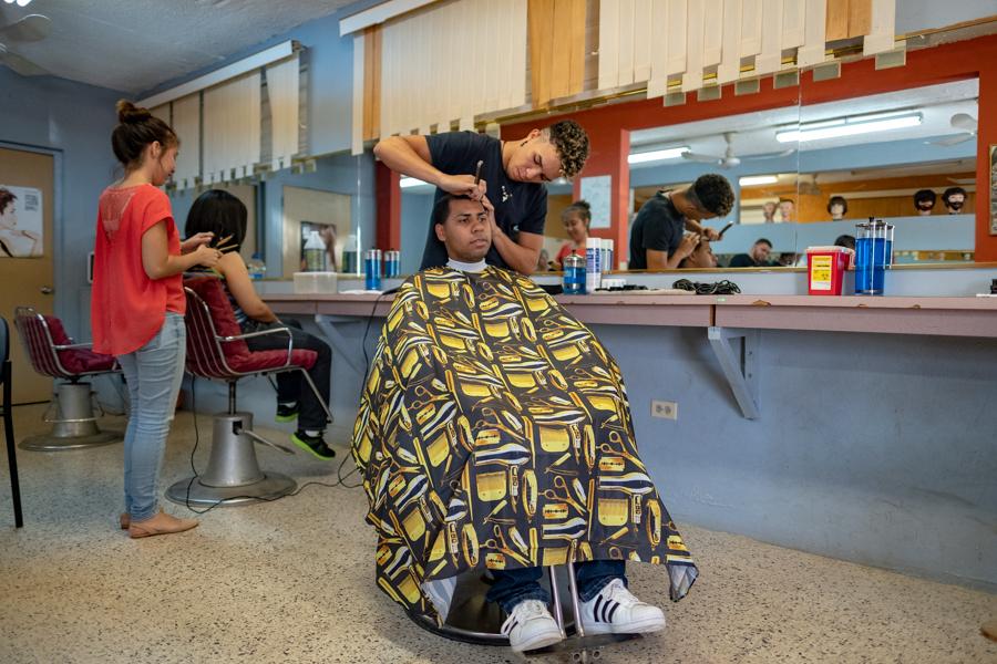 Learning the hairdresser's art in a model salon