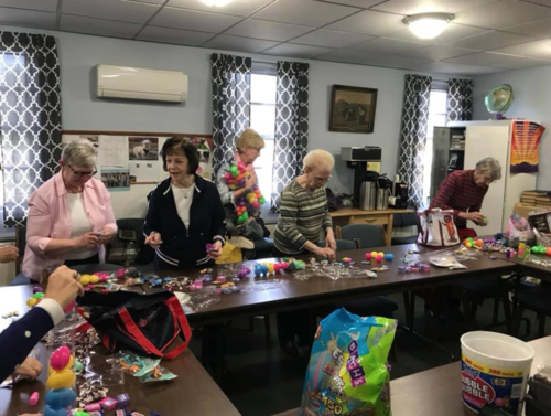 """Tara Vargo helped coordinate the Ladies of Grace from Fishburg Methodist Church to help get us ready for our """"Egg"""" stra special event by stuffing 600 plastic eggs."""