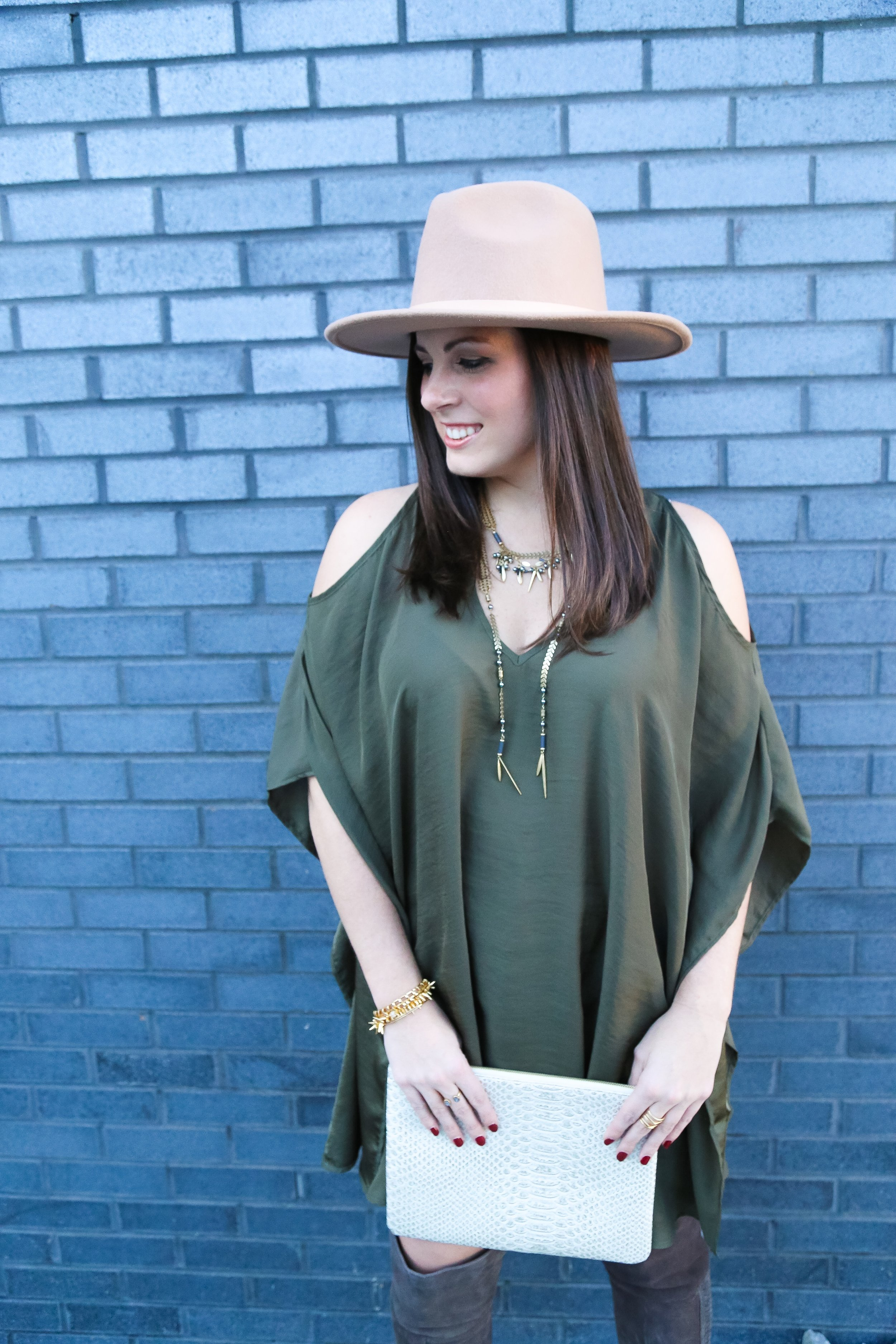 PHOTO: JESSICA VALIYI  Tunic / Hat:  e.Allen Boutique   Over The Knee Boots:  e.Allen Boutique   Accessories by  Stella & Dot    Laurel Lariat Necklace    Renegade Bracelet in Gold    Cage Cuff In Gold    All In Pouch