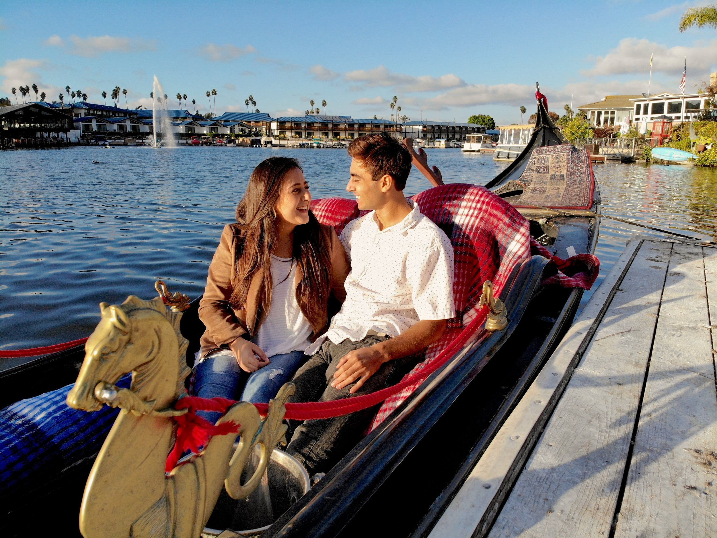 Relax and take in the peaceful scenery as your gondolier paddles you around Lake San Marcos on this one hour cruise! - Add-ons are available to enrich your gondola experience with Black Swan Gondola Company!