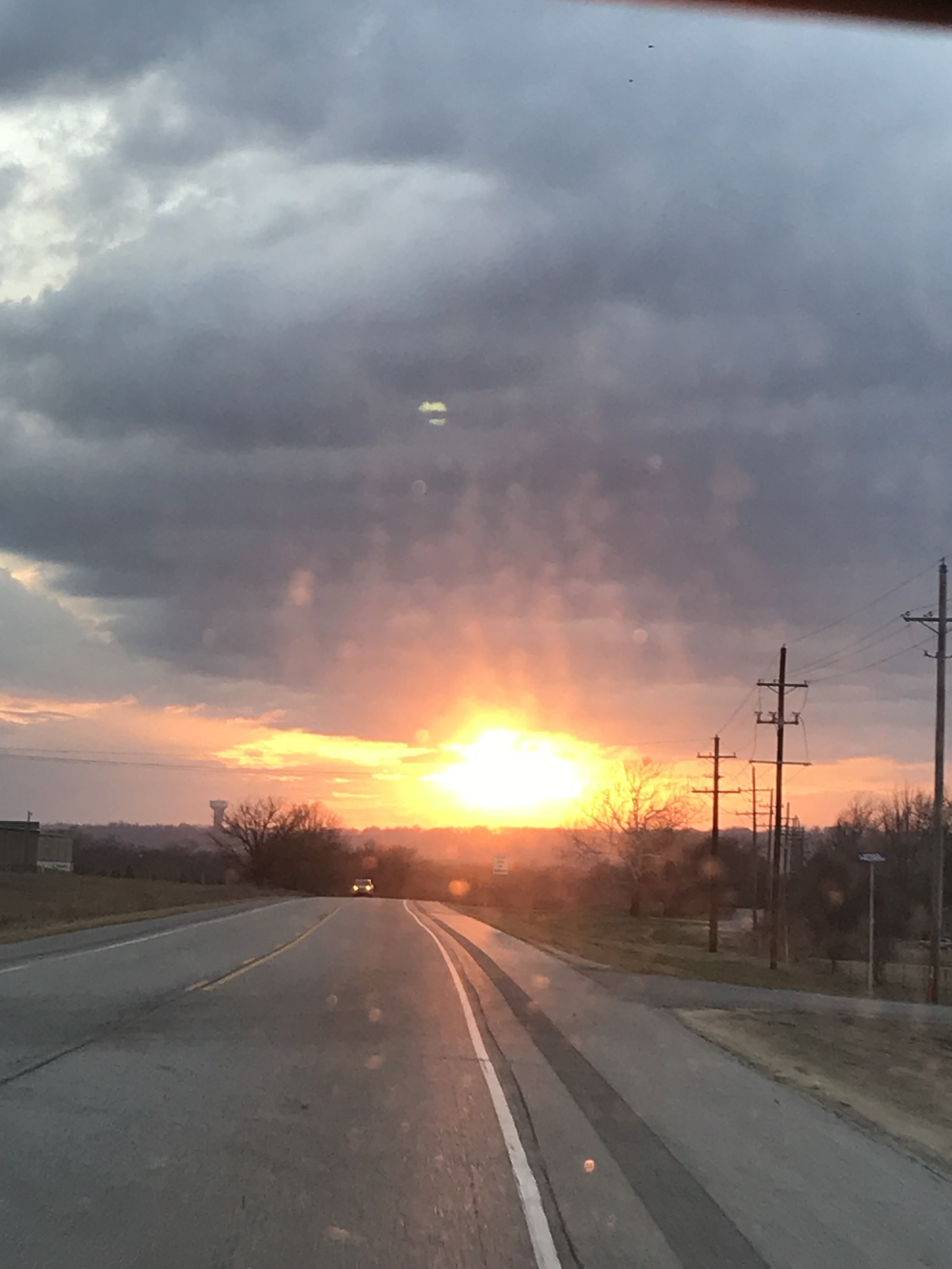 Sunset driving into Tulsa from home. Unbelievably bright!