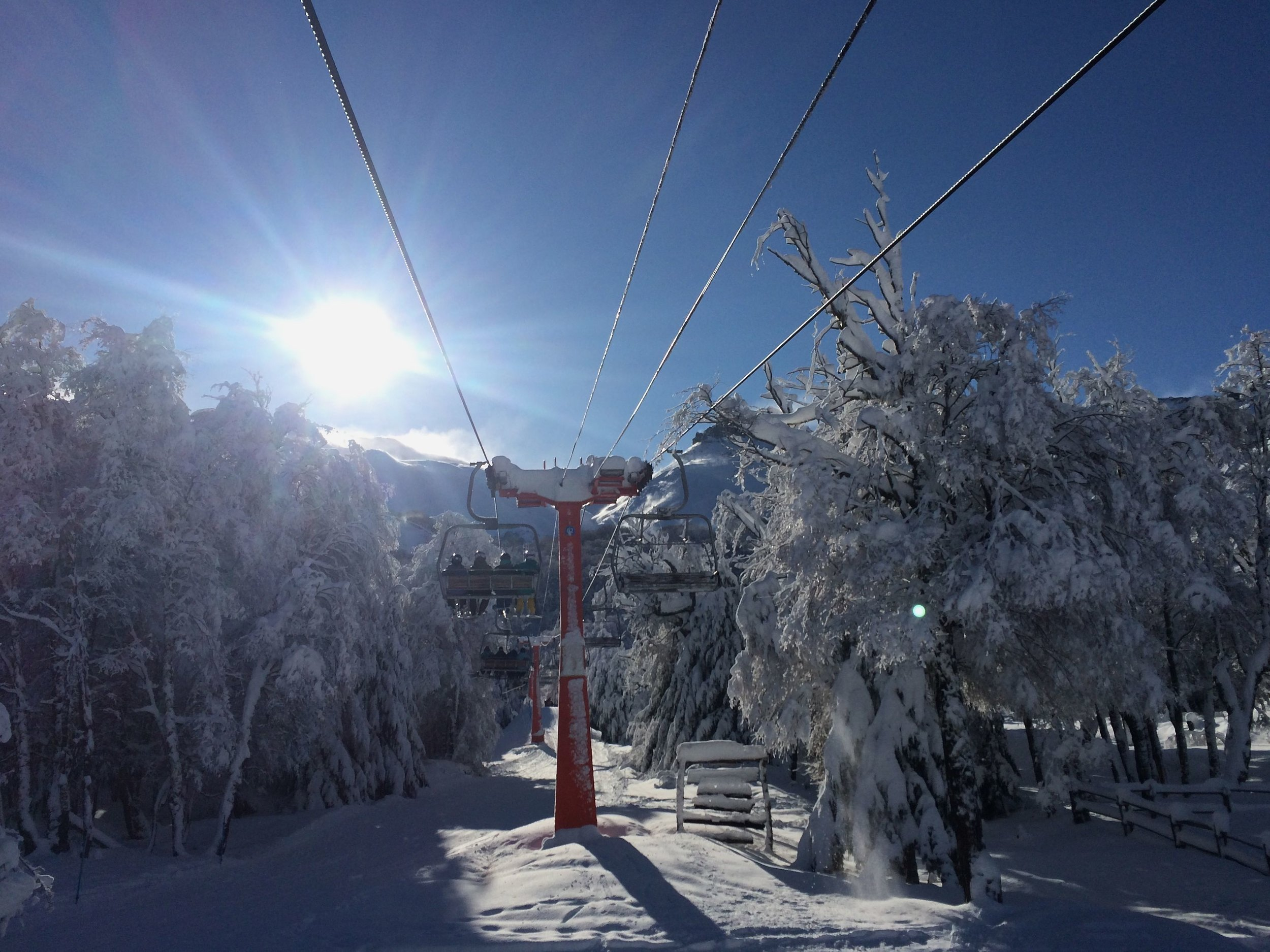 Riding the lift on our first sunny day with the campers in Chillan.
