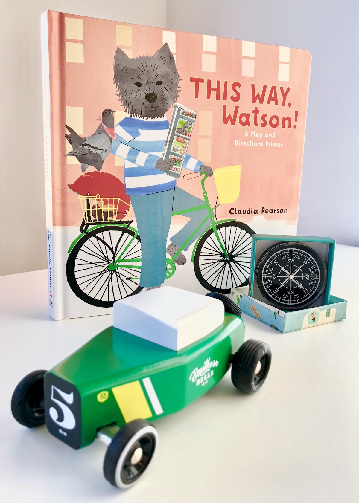 For kids on the go: - From Tiny, the sweet children's boutique that's new to Ninth Street:On-the-go gifts from Tiny for your little roadtripper! This Way Watson by Claudia Pearson (a map and directions primer!), Explorers Compass from Moulin Roty, and the Southern Belle wooden race car from Candylab. Great for nieces, nephews, and your own kiddos.