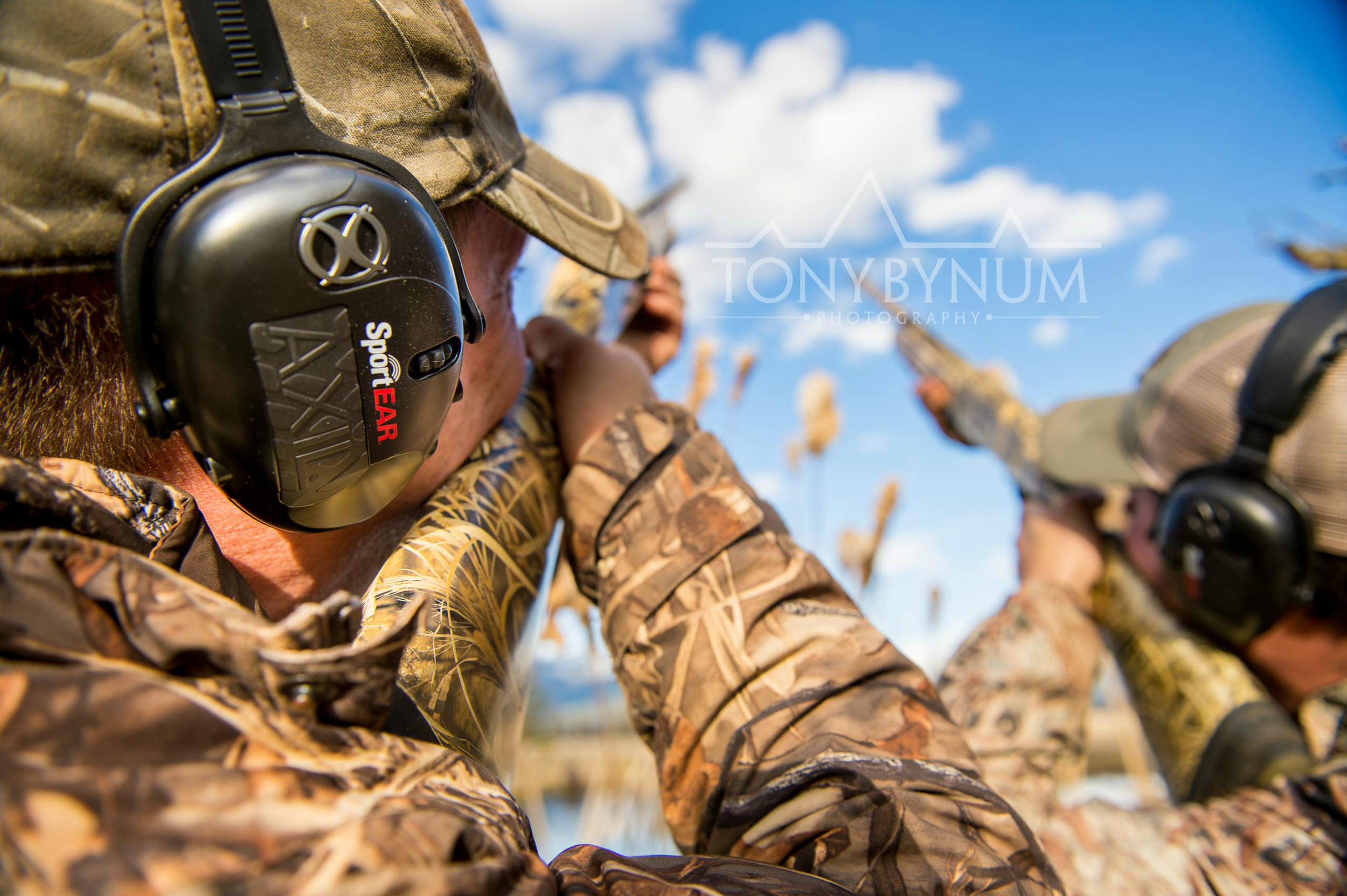 A duck hunter wearing sport ear, ear protection while hunting ducks. © Tony Bynum