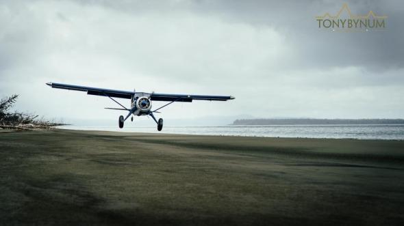 Beaver airplane lands on a beach in remote Alaska, USA