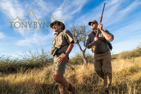 Hunter and PH stalking game in Africa