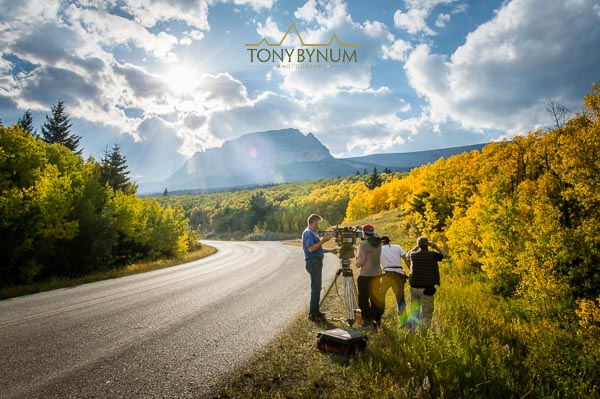 "Behind the scenes photograph of ""National Parks Adventure"" movie crew setting up to film along the going to the sun road in glacier National Park, Montana."