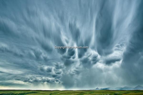 Big Sky's and summer storm along the Rocky Mountain Front, Montana. Montana Photographs (Tony Bynum/tonybynum.com)