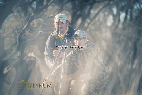 Hunter getting ready to place his rifle on the shooting sticks. La Pampa, Argentina ©tonybynum.com