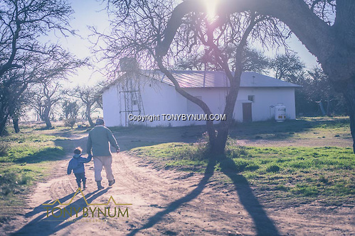 The skinner walking his son home after processing game. La Pampa, Argentina ©tonybynum.com