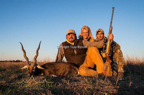 A man, his wife, and guide with a mature blackbuck. La Pampa, Argentina ©tonybynum.com