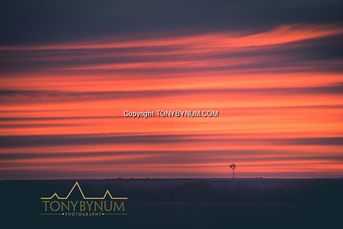 Sun sets behind one of the many windmills found throughout La Pampa, Argentina ©tonybynum.com