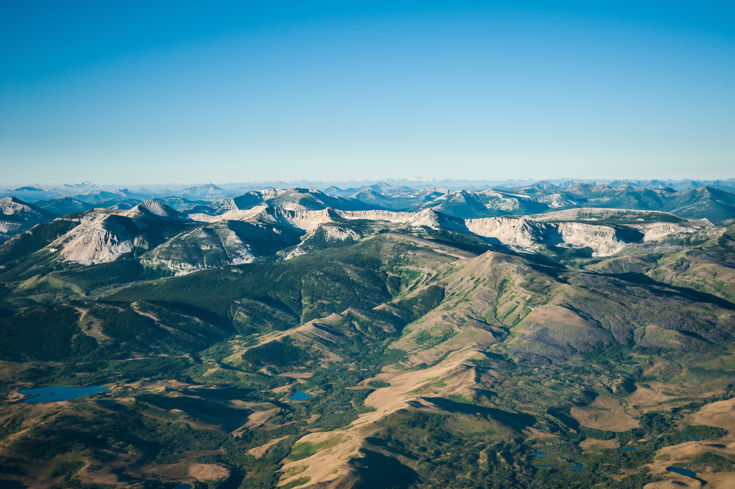 An aerial view of the Badger Two Medicine, and the in the distance, the Bob Marshall Wilderness area. This area of the Badger Two Medicine is now protected from oil and gas exploration and leasing.