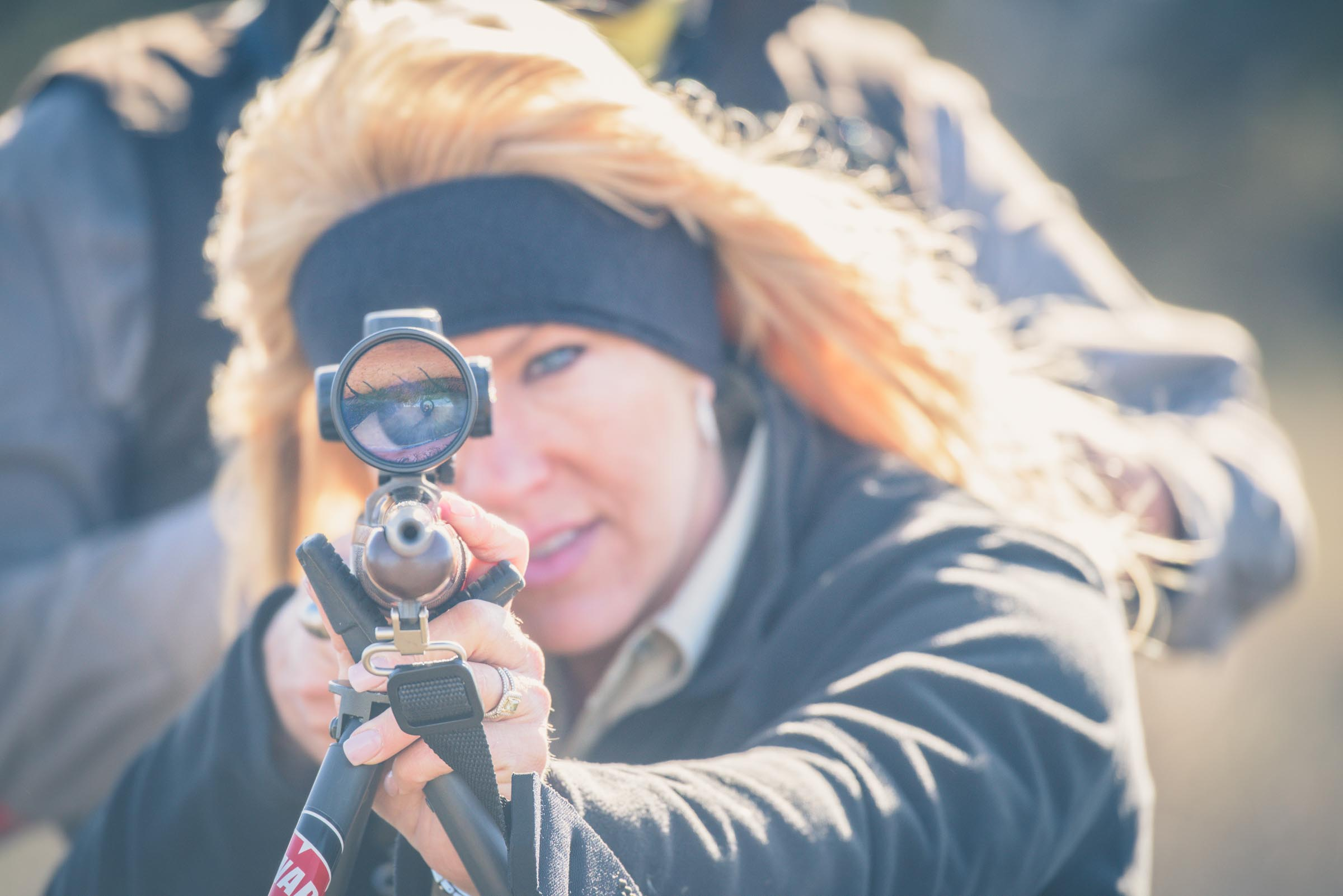 Olivia Opre taking aim while on a free range red stag hunt in La Pampa, Argentina. © Tony Bynum