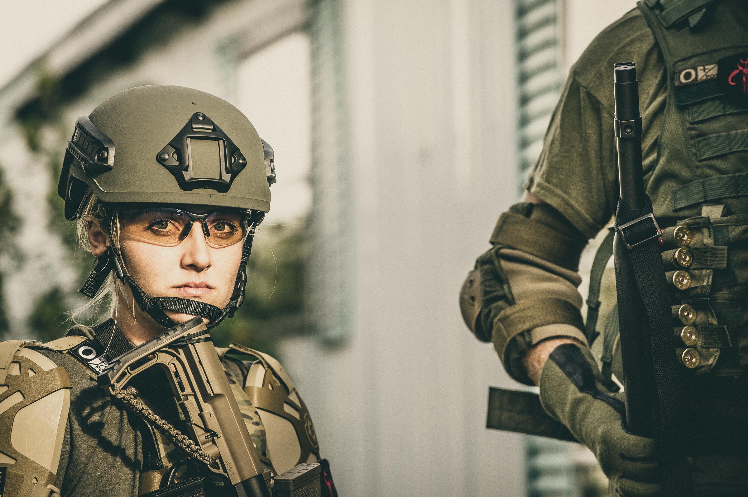 Woman swat team member preping for drug raid training. © Tony Bynum