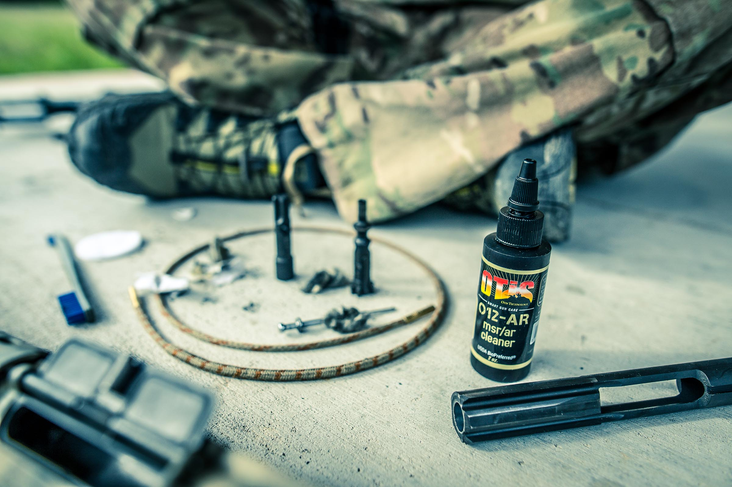 Gun cleaning with Otis AR cleaner. © Tony Bynum