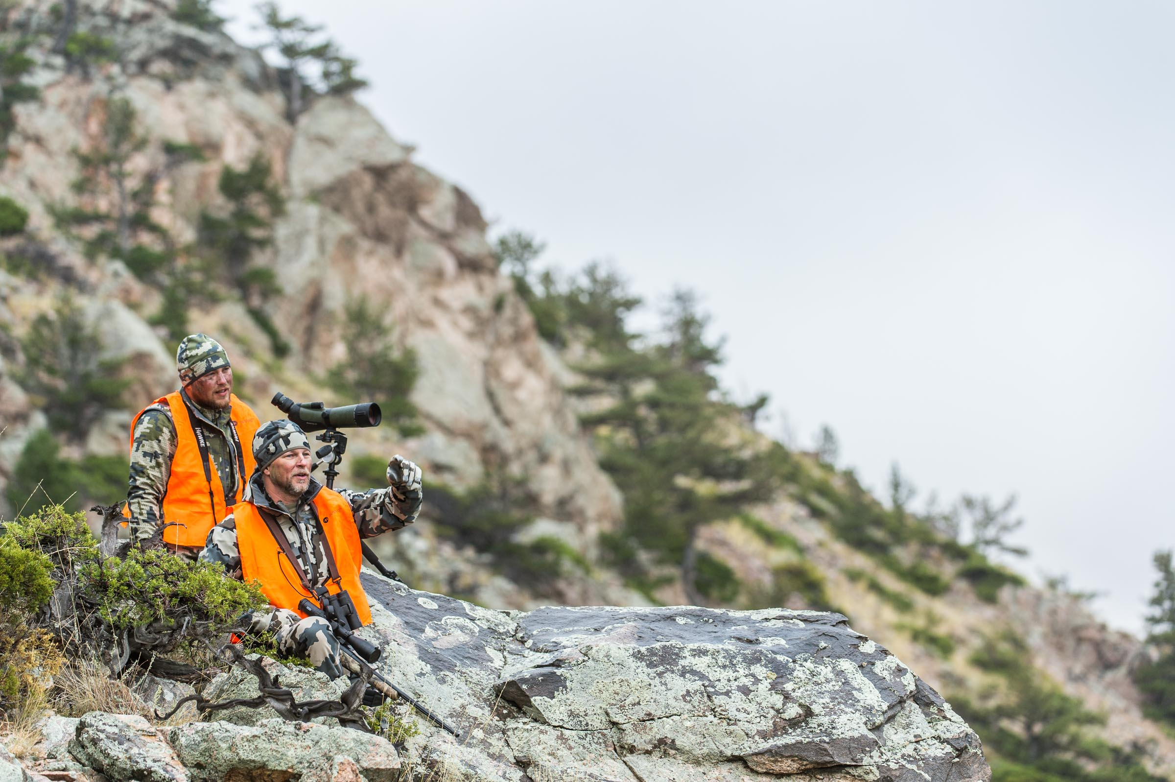 Two mountain hunters looking for deer while using Hawke optics.  © Tony Bynum