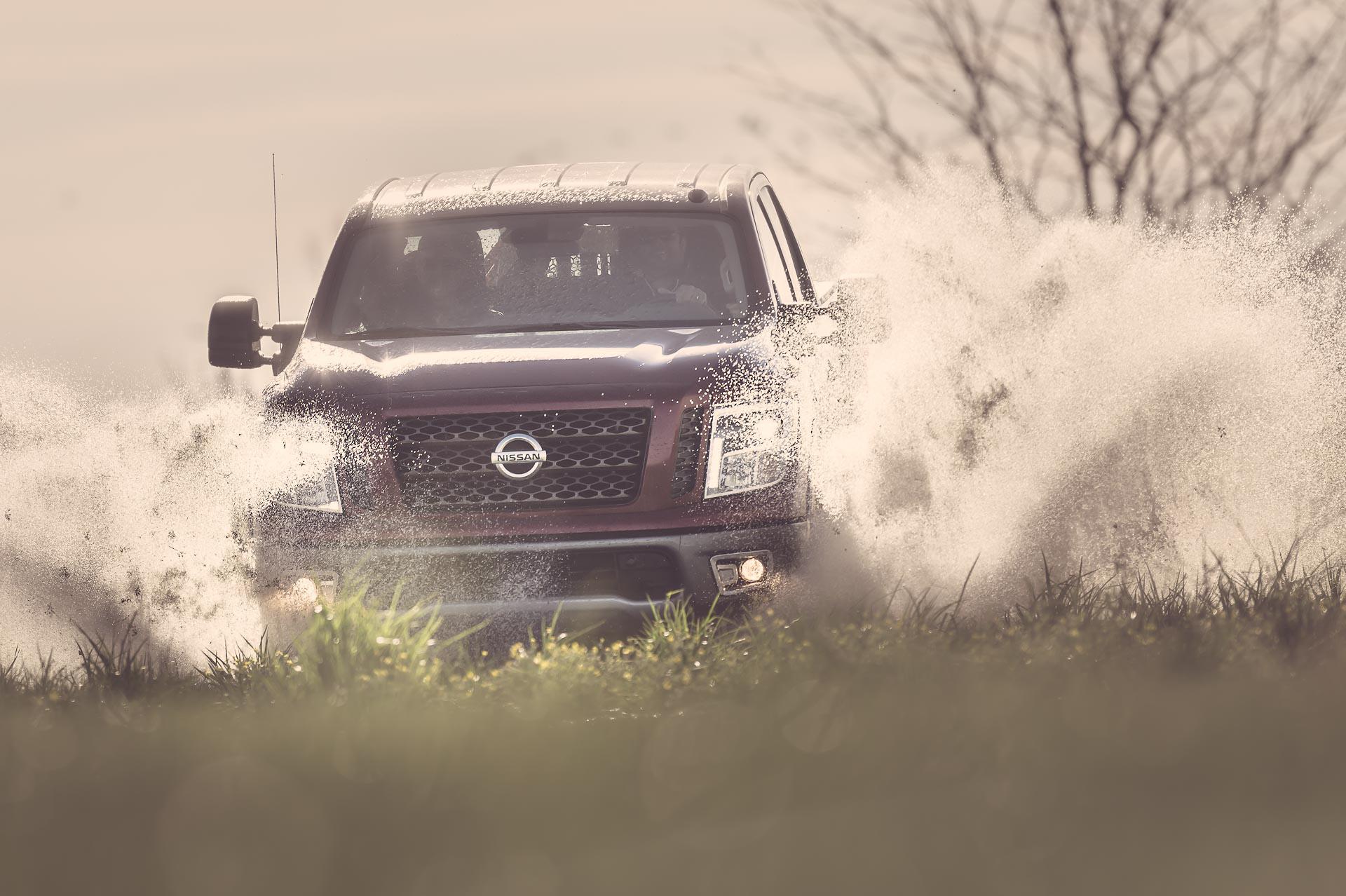 Nissan Titan Truck driving through water at Honey Brake. © Tony Bynum