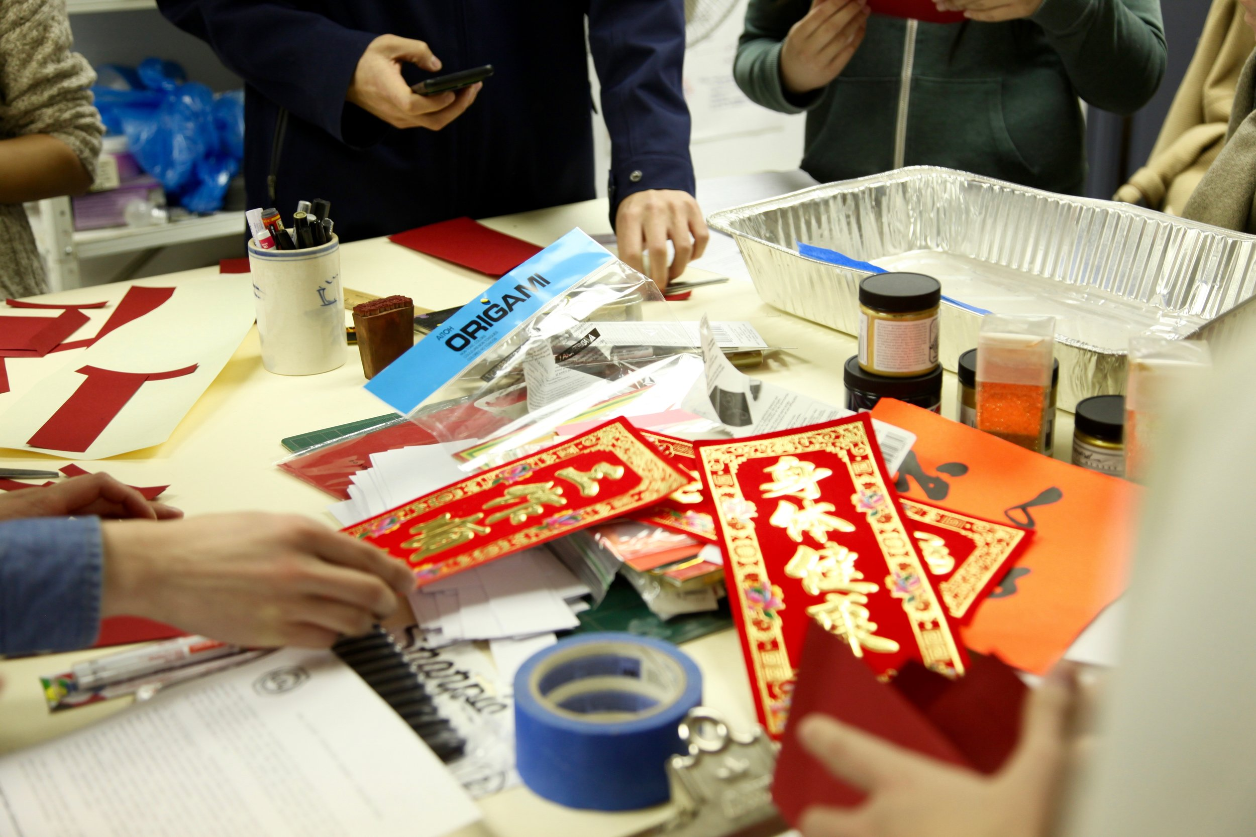 Workshop participants make red envelopes in the W.O.W screen-printing studio.
