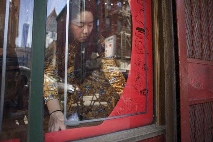 Emily Mock prepares her storefront display