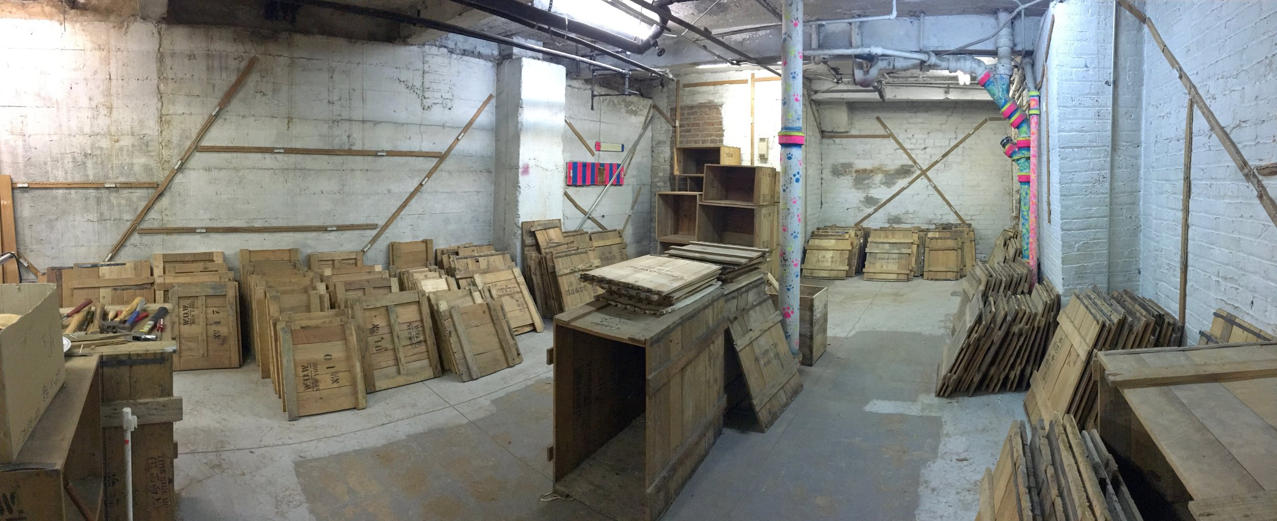 A panoramic view of our crate wood collection in our basement.