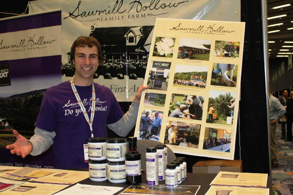 Farmer in Chief Andrew Pittz shows off Sawmill Hollow Family Farm products at Expo West 2013.