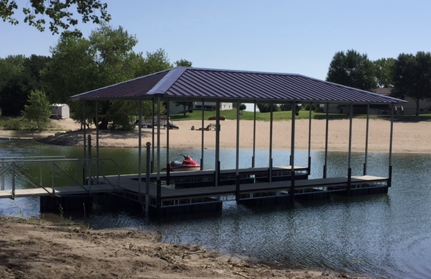 Complete concrete Shoremaster dock 12' x 32' u-shaped with hip roof, 2 jet ski shore ports and 20' walkway installed by Hotwood's crew right here in Grand Island, Ne.