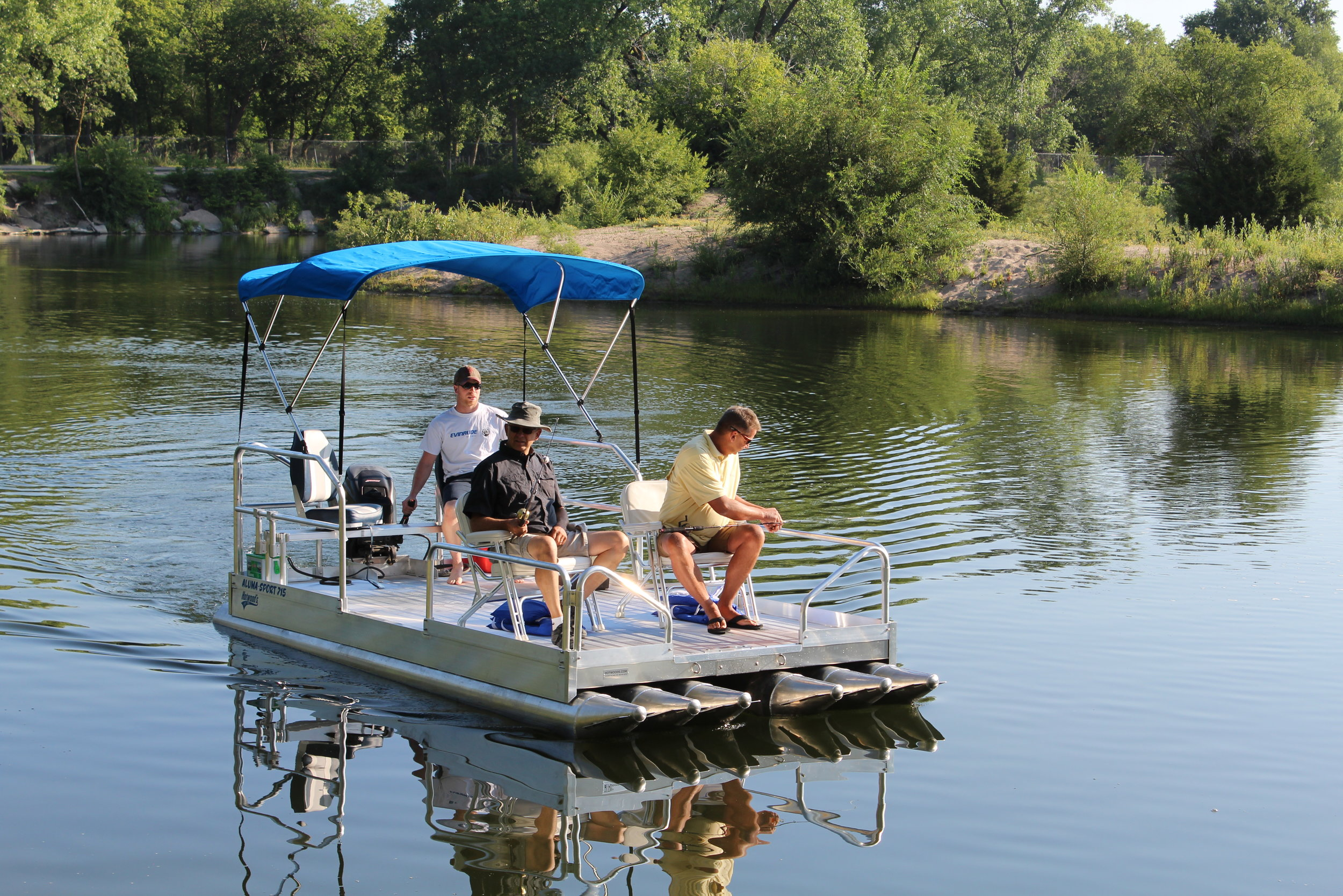 "Check out the all new 716 Aluma Sport pontoon boat, new for 2018. With 1,600 lbs. of capacity and a 25 hp rating, you will have the ability to carry more weight and move across the lake at faster speeds to get to those favorite fishing holes or locations across the water. ( Boat above is shown with optional canopy top, seating and 25 hp. outboard motor.)    This 7' wide x 16' long all aluminum pontoon boat is packed with ( 6 ) 12"" floats that by far give it the most stable platform in the industry for a boat this size. Pontoons are .090 thick aluminum, with .100 thickness on cones and end caps.( That is the heaviest in the industry ) The 716 Aluma Sport weighs 875 lbs, with the trailer weighing 620 lbs. for a combined pulling weight of 1,495 lbs. That makes it very easy to pull with the lightest pickup or like vehicle on the road.    We are personally involved with every boat we have ever designed or manufactured, and after 2 years in development, we can say, this boat is incredible when it comes to maneuverability and stability. We have just never seen anything like it on the water. This craft is literally like walking around on your patio.    Quality, you need not question the construction of this craft, like all our pontoon boats and docks we manufacture, there is nothing to compare them to. The 716 Aluma Sport is manufactured completely of aluminum with stainless steel hardware. We tell people everyday they could bury this boat and dig it up 20 years later and go boating.    We are now in full production and taking orders on the 716 Aluma Sport and Shoreland'r trailer. ( Please call for pricing and delivery dates toll free 877-407-8645 )"
