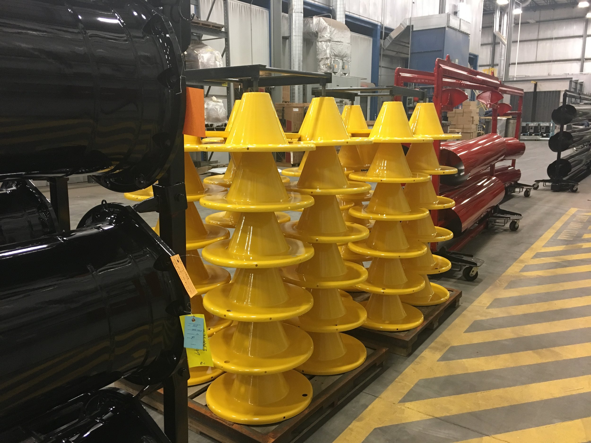 Our complete wire winder line goes through the process of baked on powder coated paint. This system provides premium paint to assure the best coverage available. Above we have split reels fresh from the oven, ready to be boxed and shipped to customers.